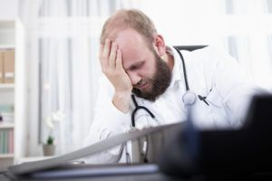 Depressed doctor over his wrong diagnosis.