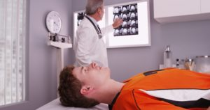A man with a brain injury is getting a head scan in Columbia