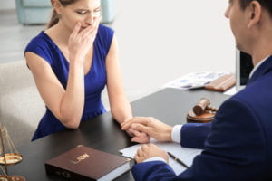 A woman is consulted by our Columbia wrongful death lawyers.