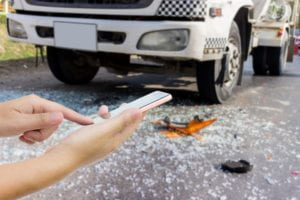 Taking photo in truck accident.