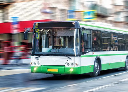 bus driving on city streets