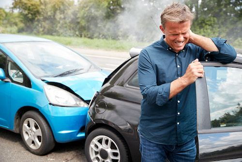 Man Holding his neck in pain after car accient