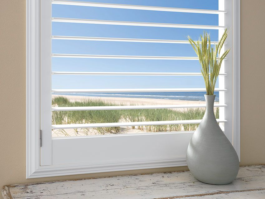 plantation shutters with a 3.5 inch louver by ashade above window fashions