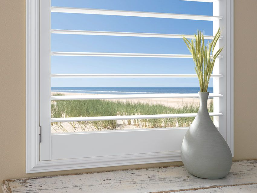 Plantation shutters with 4.5inch louver by a shade above window fashions