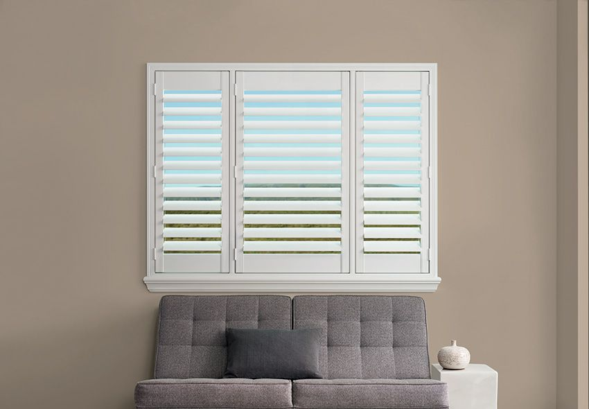 plantation shutters with measured t position by a shade above window fashions