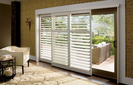 plantation shutters for sliding glass doors open bypass track by a shade above window fashions