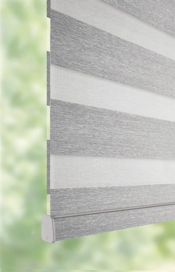 close up of a transition blind to illustration the transitional pattern by a shade above window fashions