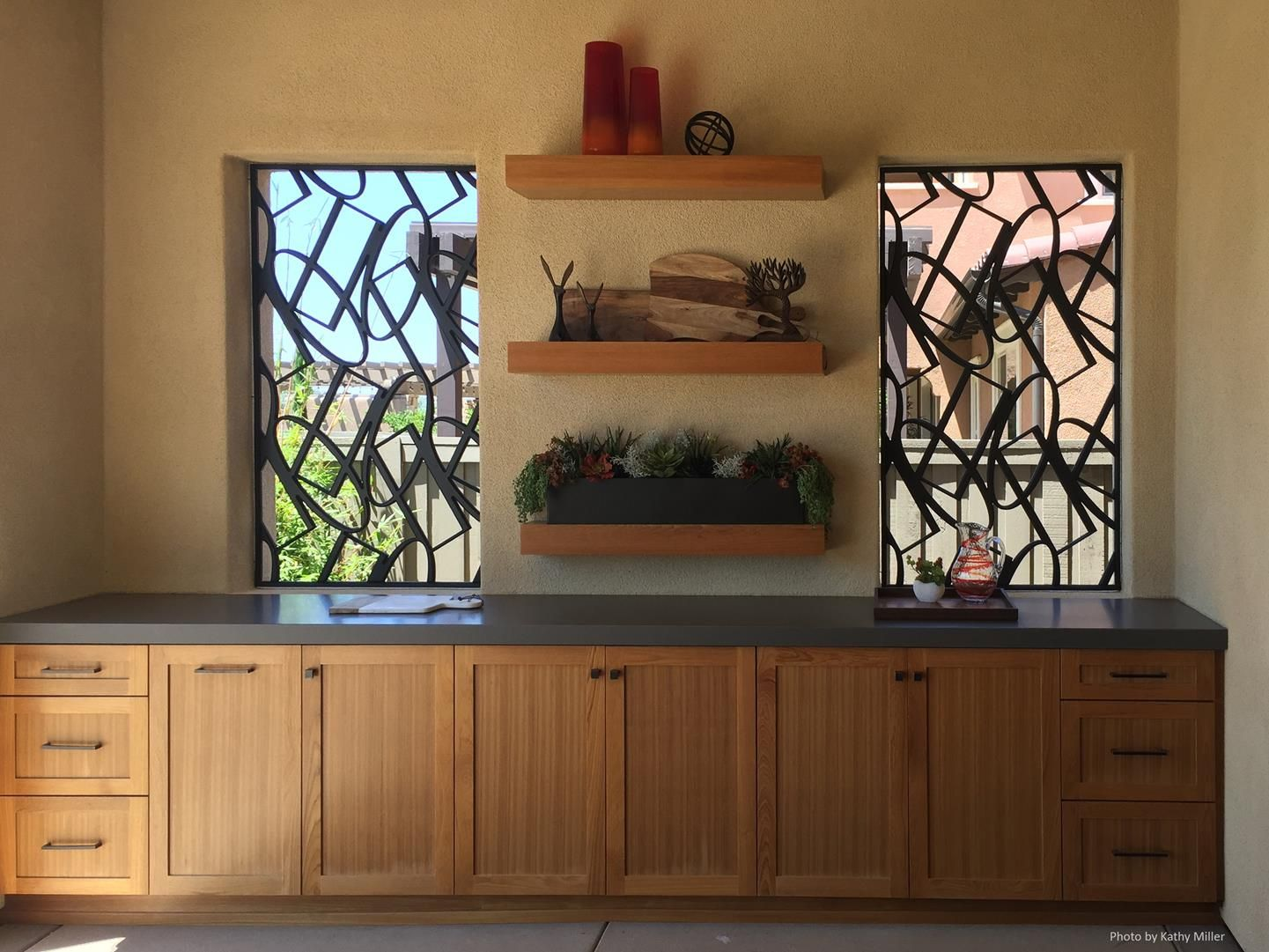 outdoor kitchen decorative grille by a shade above window fashions