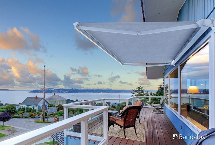 retractable awnings on raised deck by a shade above window fashions
