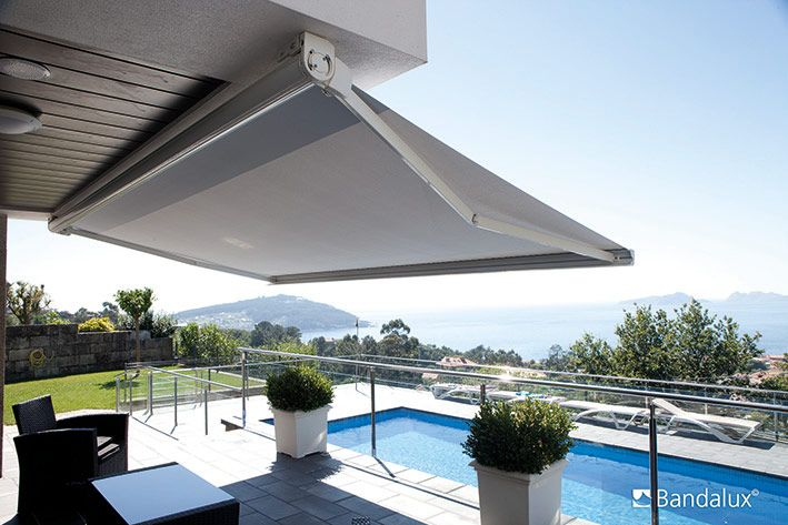 retractable awnings by a shade above window fashions