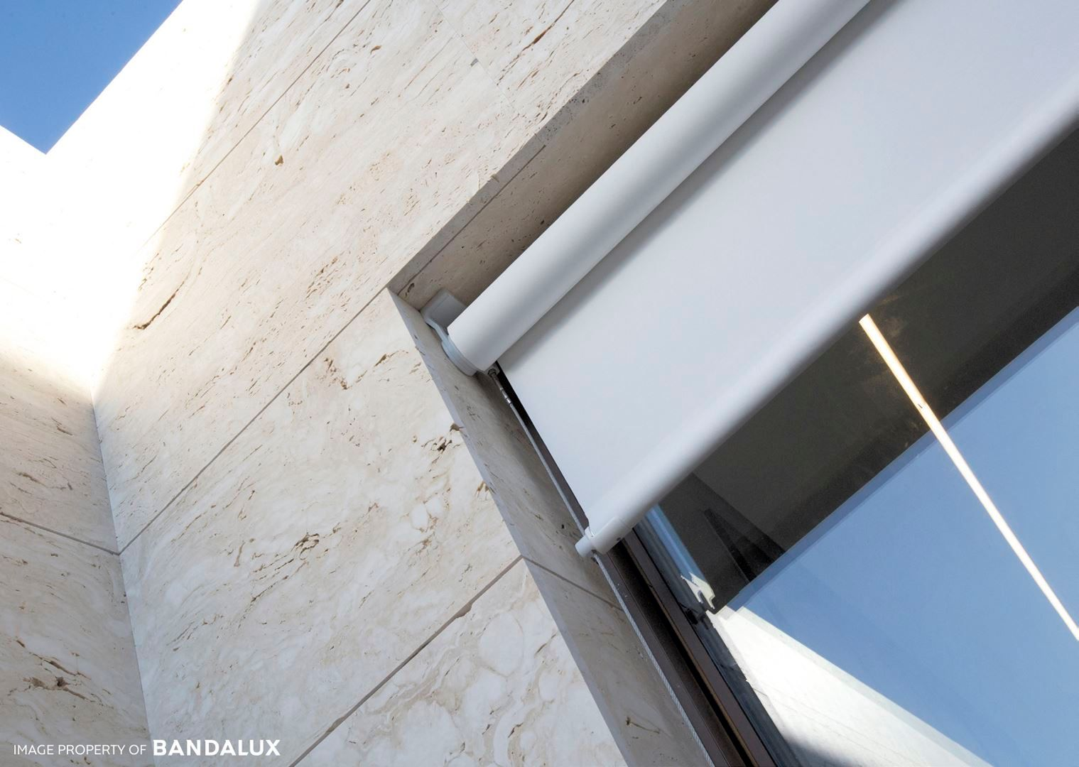 outdoor roller shade by a shade above window fashions