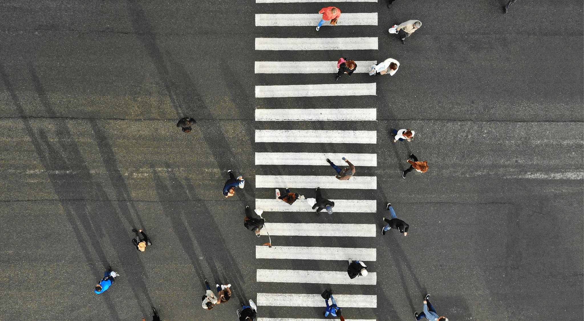 pedestrians crossing crosswalk