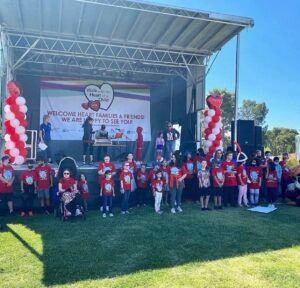 childrens of Children's Heart Foundation's standing in front of a stadium