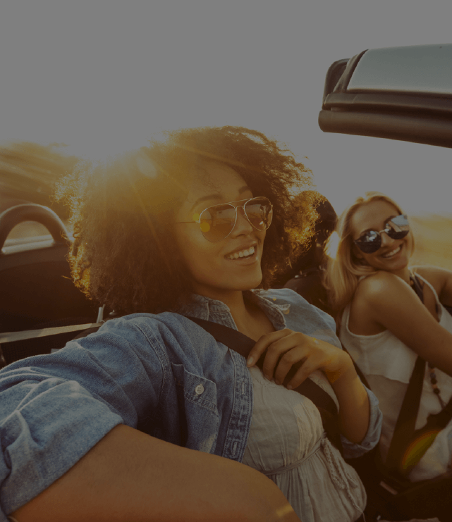 People chilling on a convertible moving car