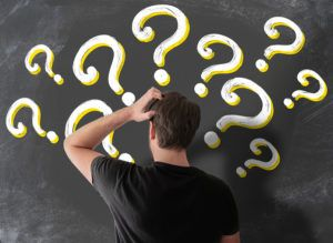Puzzled Florida man with question marks around his head on chalkboard