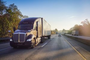 Florida Personal Injury Lawyer Commercial Truck Driving at Sunset