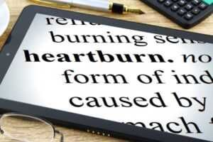 Tablet with heartburn in black text